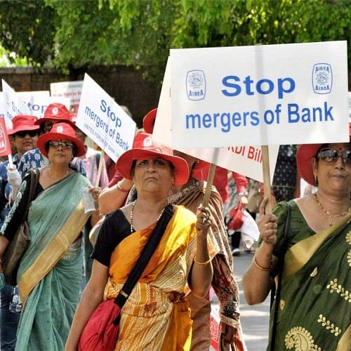 Bank employees protest against the mergers (PTI photo)