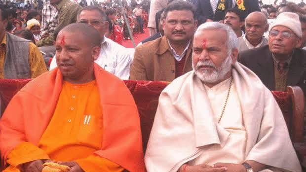 In this file photo, UP Chief Minister Yogi Adityanath is seen with fellow party leader Swami Chinmayanand who has been accused by a student of raping her (file photo).