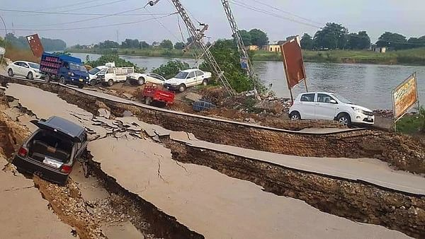 As the earthquake hit the PoK, roads developed deep cracks, several houses collapsed and the upper Jhelum canal's banks were damaged at various places, inundating villages along the canal (PTI photo).