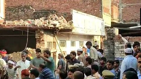 12 killed after a two-storey building collapsed following a cylinder blast in Mau, UP