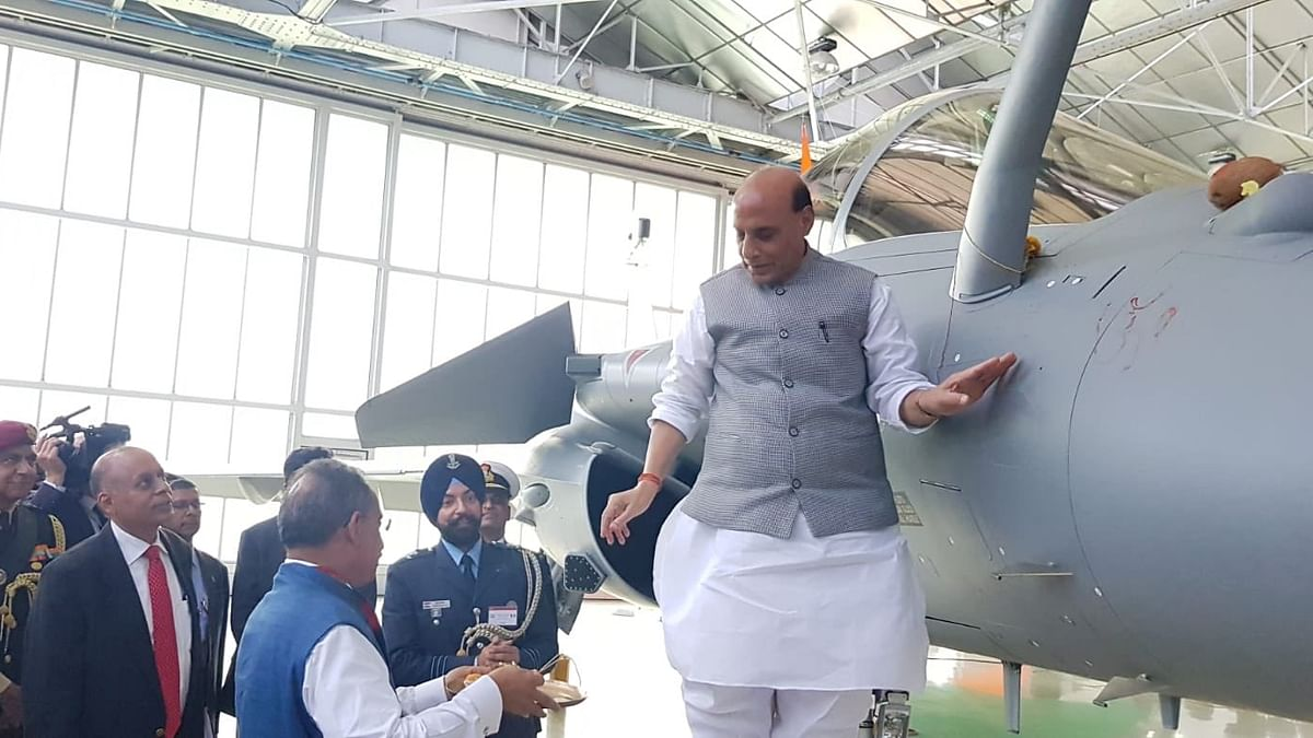 Defence Minister Rajnath Singh performing the 'puja' of Rafale fighter jet.