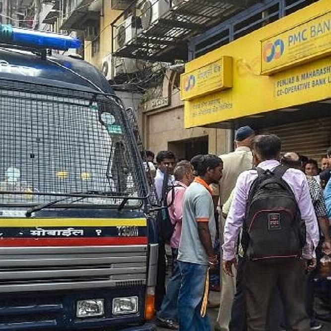 Hapless customers throng a branch of the PMC Bank in Mumbai (PTI photo)
