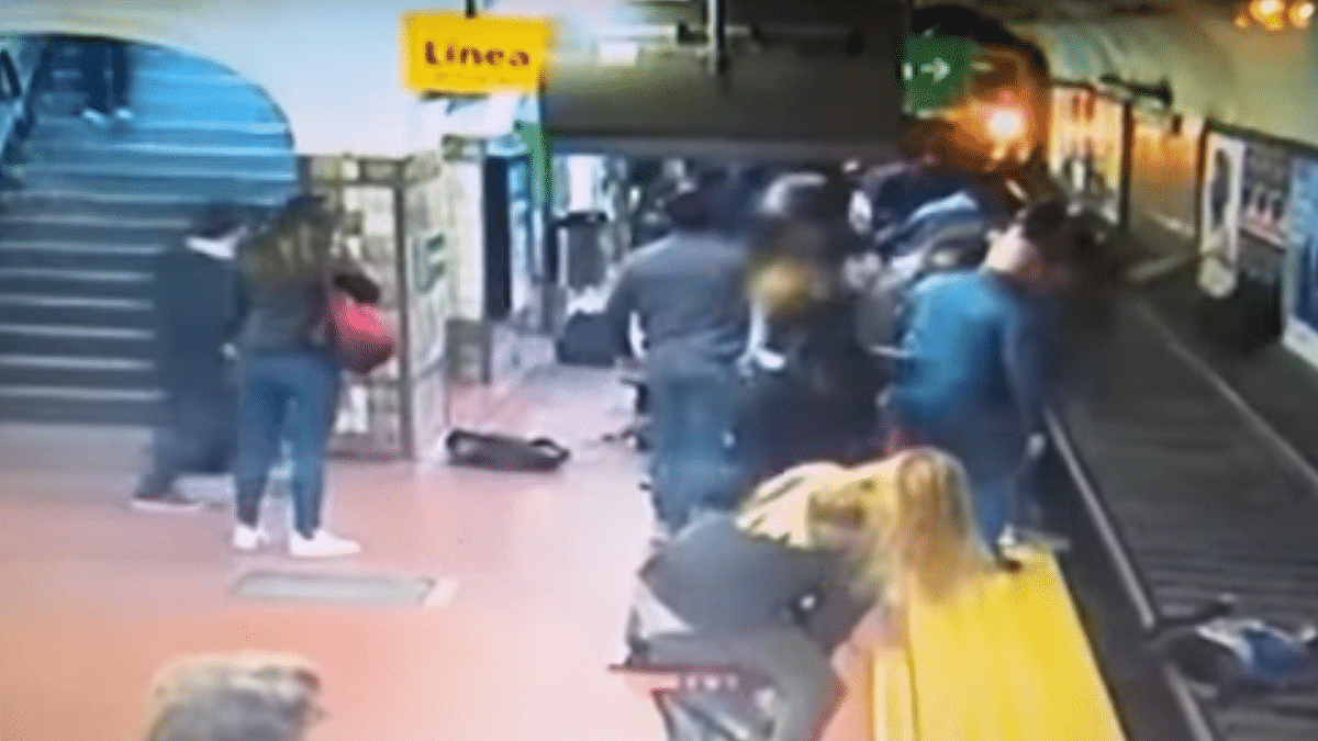 WATCH : Woman in Argentina rescued after commuter faints and falls onto subway tracks