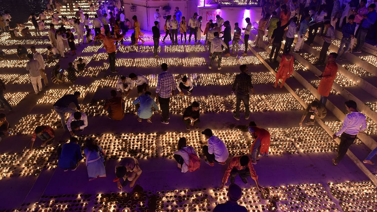 People light oil lamps during 'Deepotsav' in Ayodhya on October 26, 2019. (Photo: IANS)