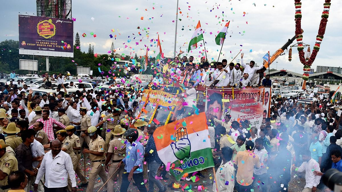 Congress leader D K Shivakumar being welcomed by his supporters on his arrival in Bengaluru on Saturday, Oct 26, 2019. (PTI Photo)
