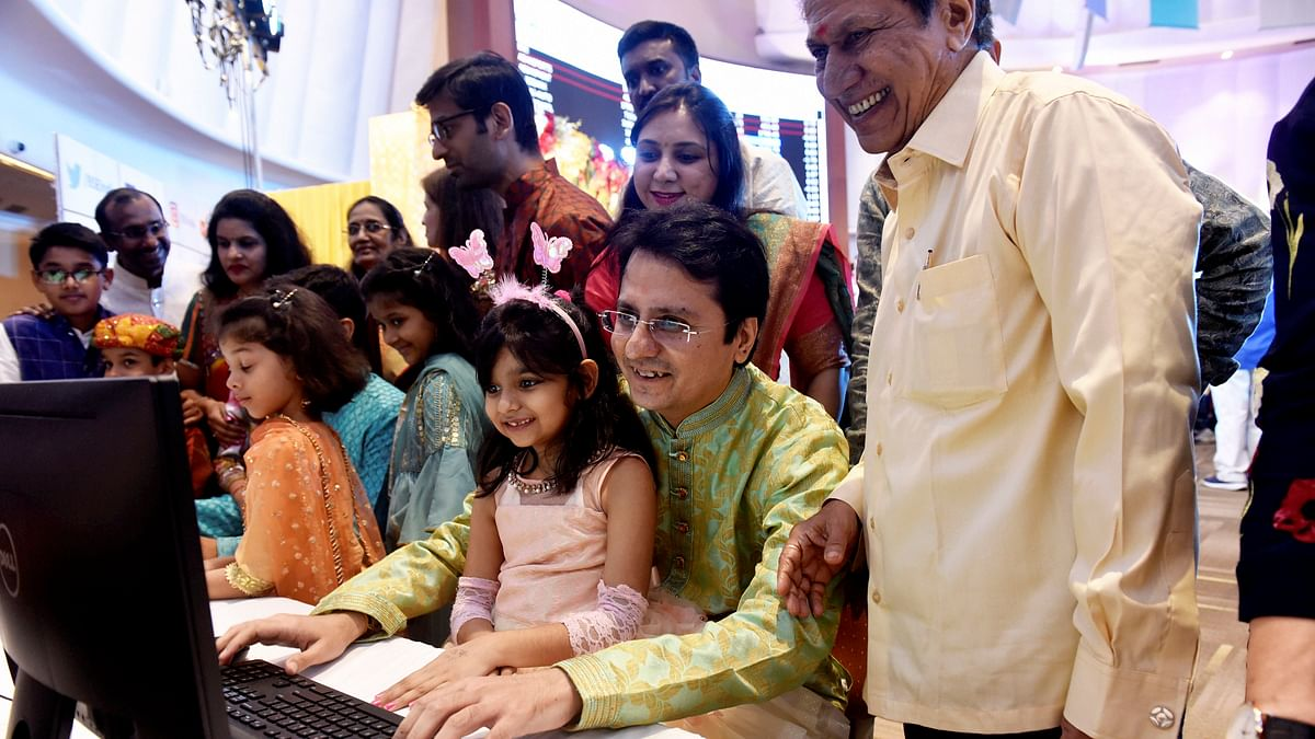 Stockbrokers trade as their families watch during a special 'muhurat' trading session for Diwali at BSE in Mumbai on Sunday, Oct 27 (PTI Photo).