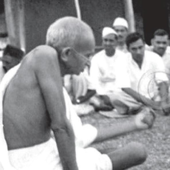 Gandhi with people from Harijan community