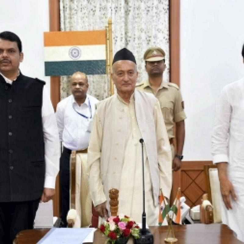 Devendra Fadnavis (left) and Ajit Pawar with Maharashtra Governor Bhagat Singh Koshyari after he administered them oath of office on Saturday, Nov 23, 2019