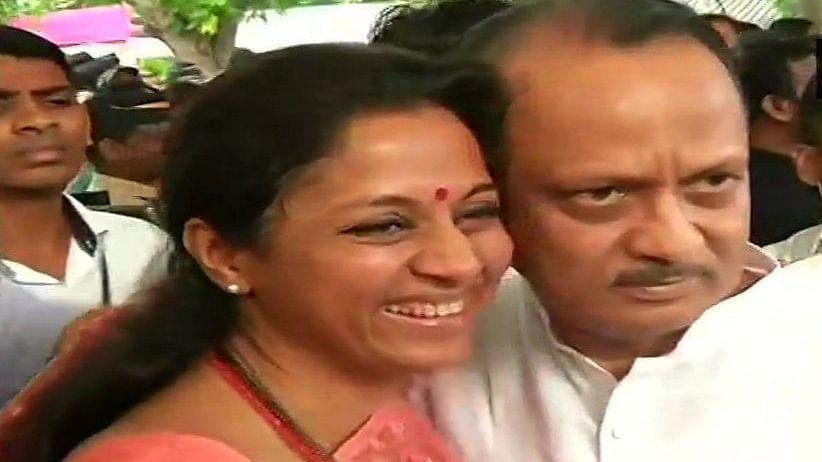 Supriya Sule greets cousin Ajit Pawar with a hug before Maharashtra session