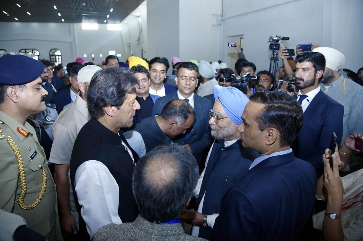 Pak PM Imran Khan interacts with former Indian PM Dr Manmohan Singh during the inauguration ceremony of Kartarpur Sahib Corridor