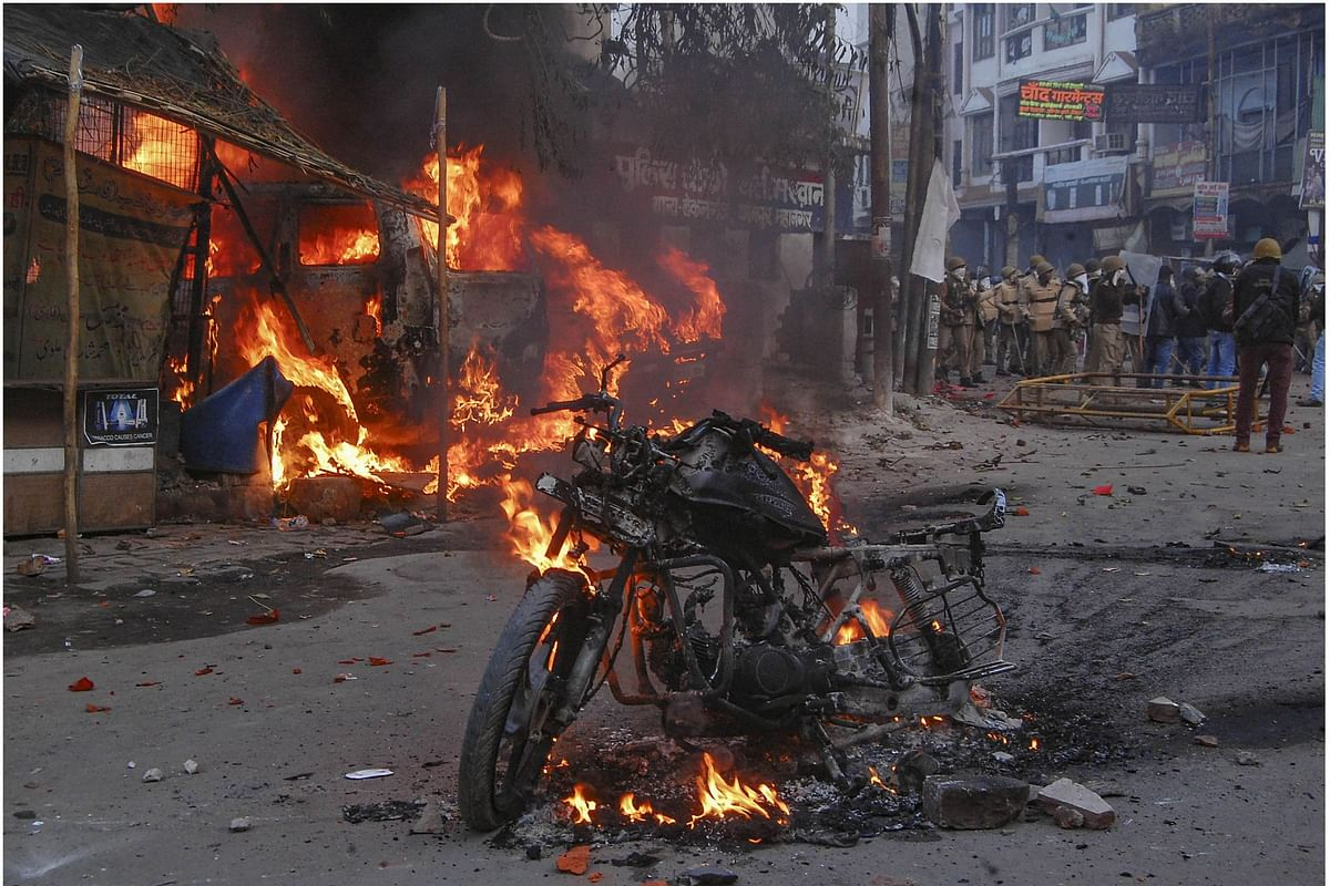 A vehicle torched allegedly by protesters during a demonstration against the Citizenship Amendment Act in Kanpur, Uttar Pradesh, on Saturday, Dec 21, 2019. (PTI photo)