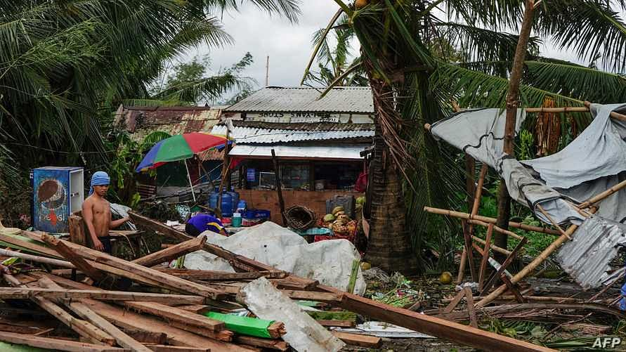 Toll in Philippines typhoon reaches 21
