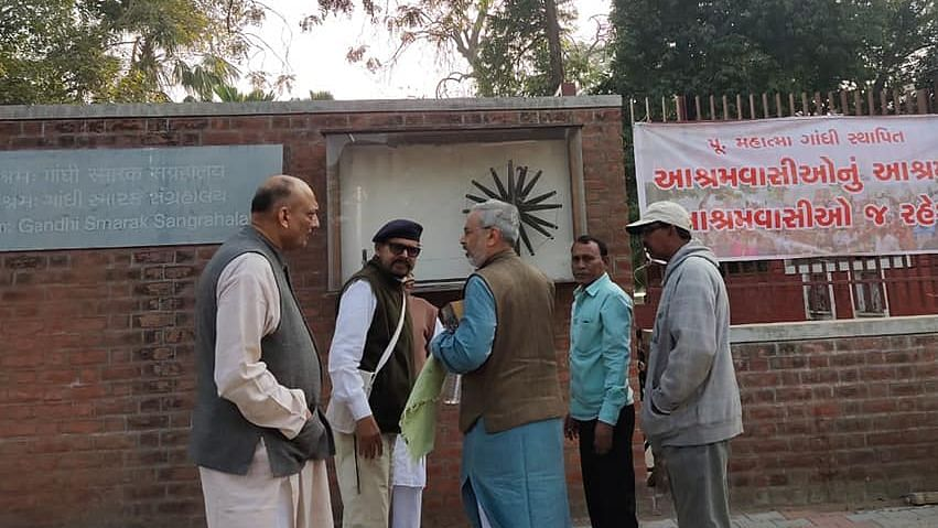 Nachiketa Desai (centre) being asked to leave Ashram by management.