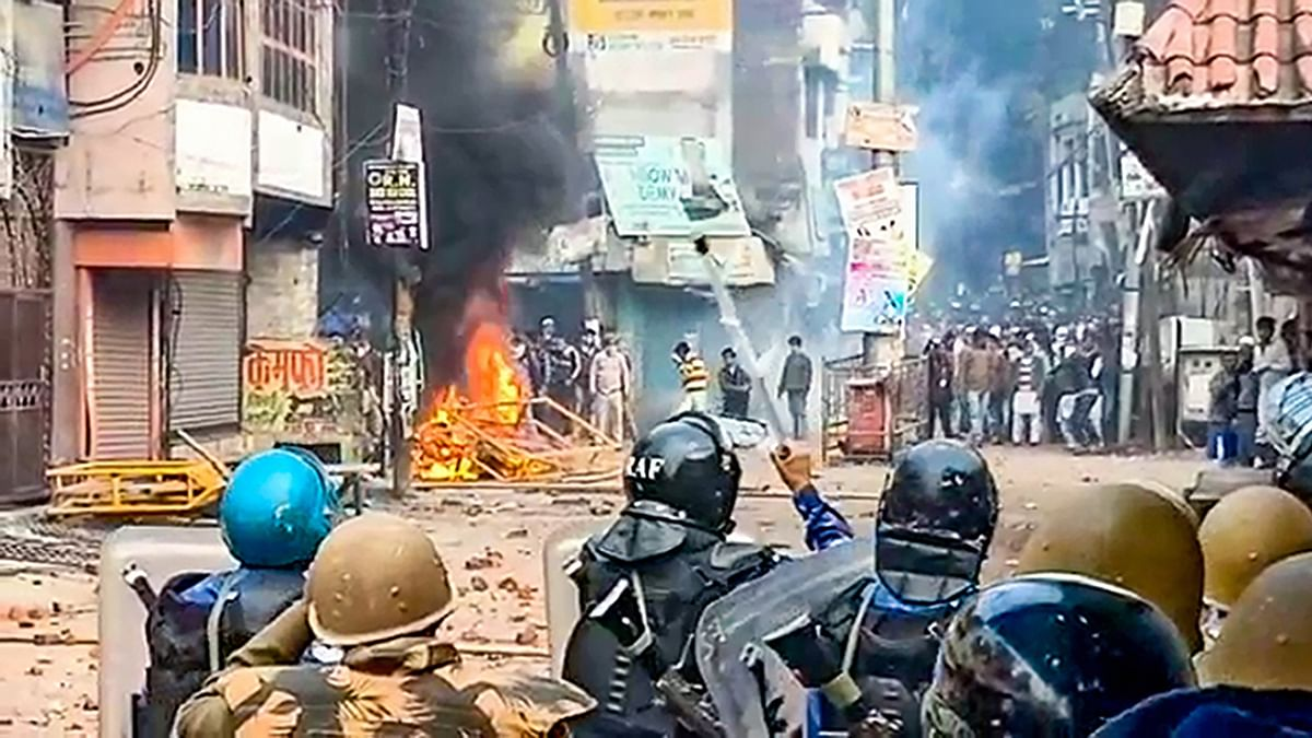 Police personnel clash with protesters demonstrating against the Citizenship Amendment Act in UP's Rampur on Saturday, Dec 21, 2019. (PTI photo)