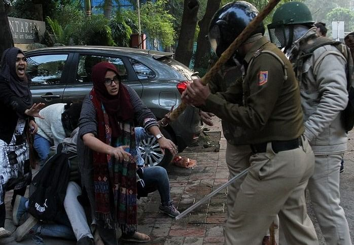 The two girls standing up to policemen who are brutally raining batons at one and all during anti-CAA protest on Sunday.