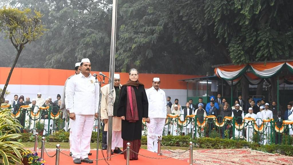 Congress interim President Sonia Gandhi hoists tricolour at party office in Delhi on 135th Congress foundation day