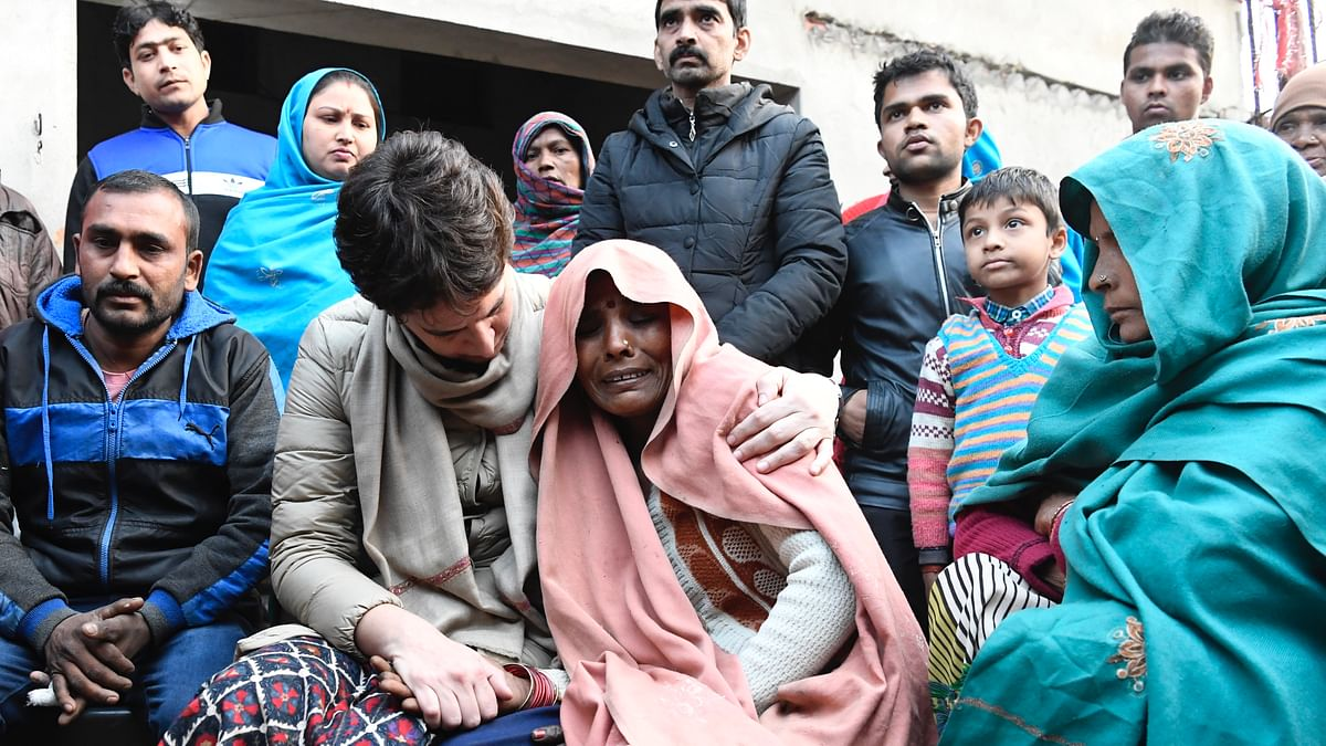 Priyanka Gandhi consoles the mother of Suleman who was allegedly killed in police firing during anti-CAA protest on Friday, in UP's Nehtaur, Sunday Dec 22, 2019. (Photo courtesy: AICC)