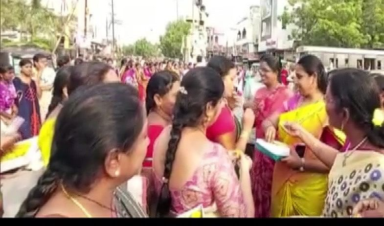 Women in Jaggaiahpeta in Andhra Pradesh's Krishna district distribute sweets after the news of killing by police of four rape accused of Hyderabad vet came out.
