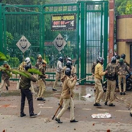 Police personnel outside Jamia Millia Islamia as students stage a protest against the Citizenship (Amendment) Act (PTI Photo) (File Photo)