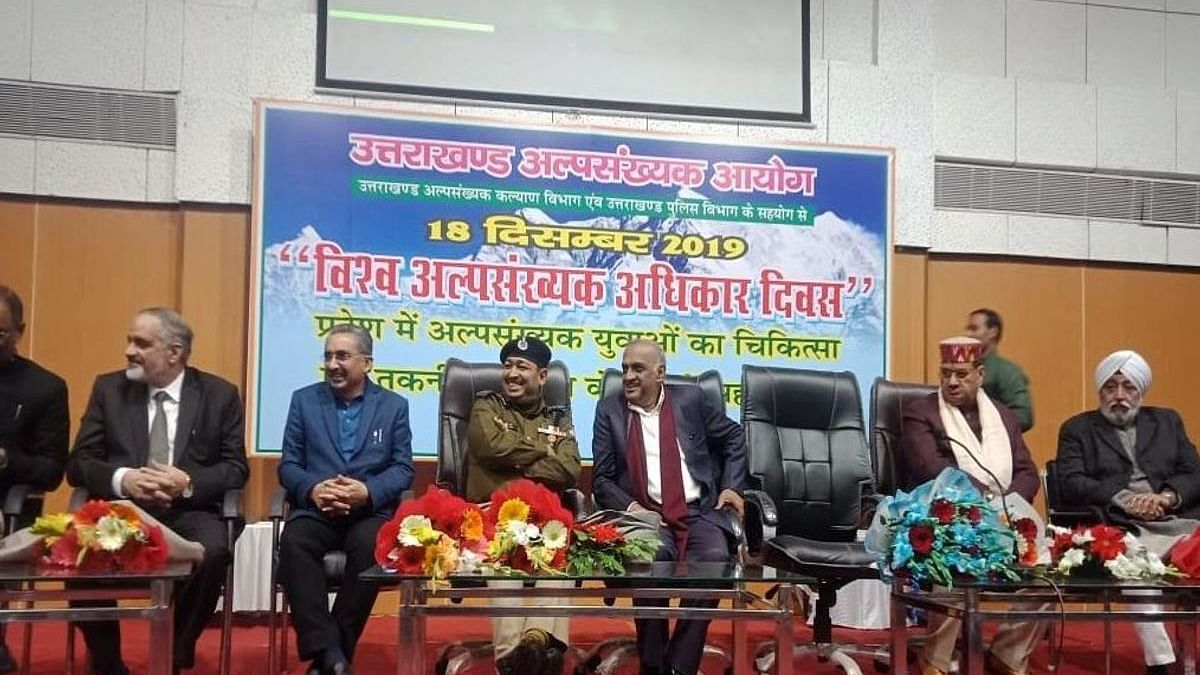 Participants at a function organised on Minority Rights Day by Uttarakhand minority commission which was skipped by Union HRD Minister Ramesh Pokhriyal Nishank in Dehradun on Wednesday