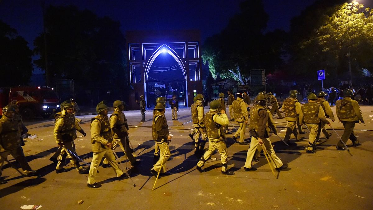 Policemen stand guard near Jamia Millia Islamia following the protests against Citizenship Amendment Act, in New Delhi, Sunday, Dec. 15, 2019 (PTI Photo)