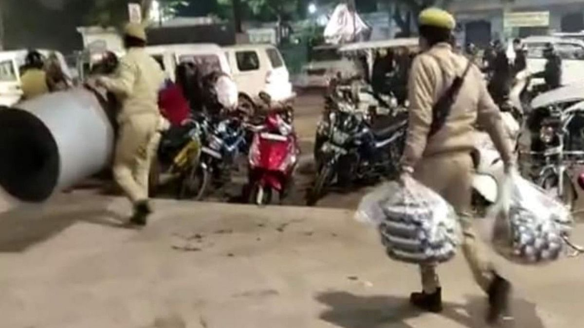 UP police taking away blankets from women protesters on Saturday night (Photo courtesy- social media)