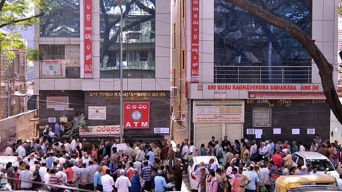 Fearing PMC bank like crisis, anxious depositors mill around Bengaluru Bank  after RBI caps withdrawal limit