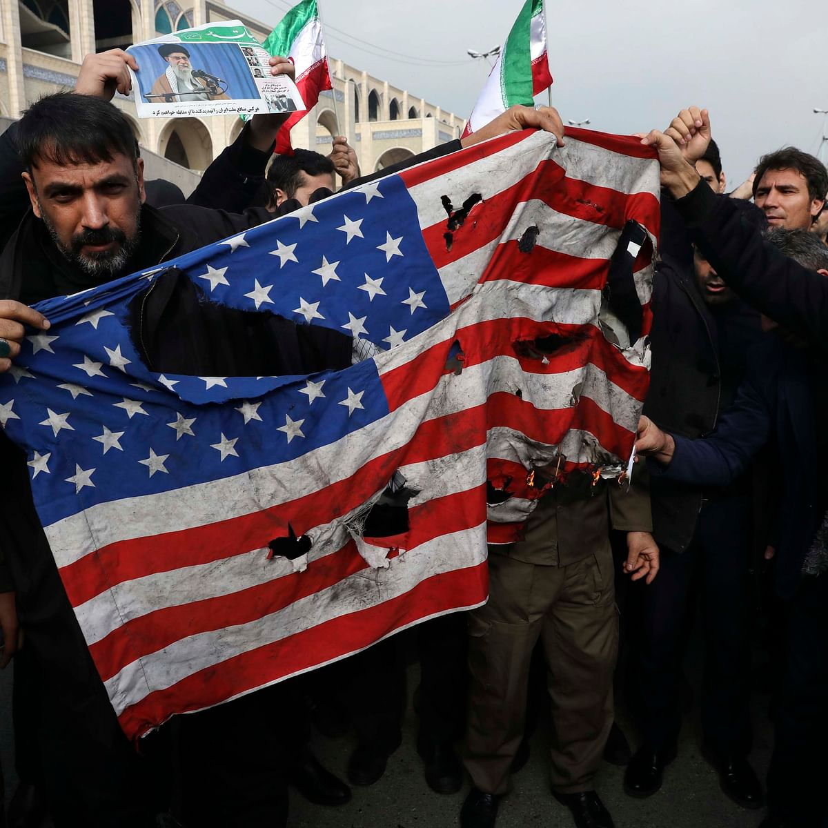 Protesters burn a U.S. flag during a demonstration over the U.S. airstrike in Iraq that killed Iranian Revolutionary Guard Gen. Qassem Soleimani, in Tehran (PTI)