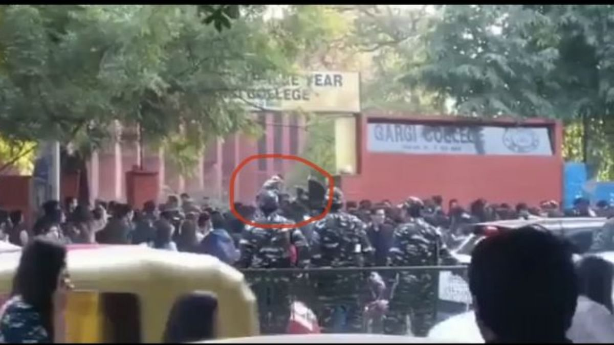Video grab showing men jumping across the closed gate in front of securities personnel (Photo courtesy- social media)