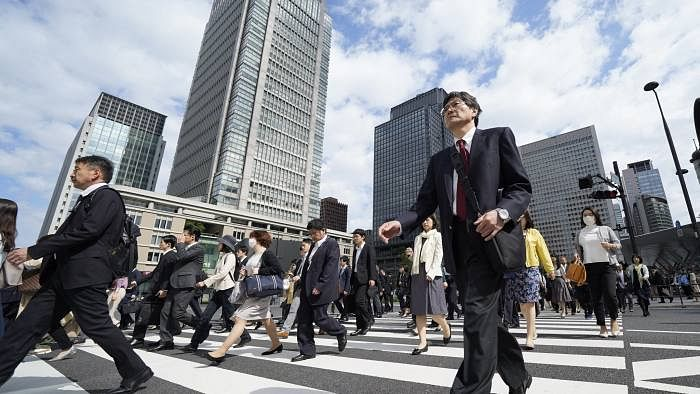 Japan's economy shrinks 7% in last quarter, risks recession