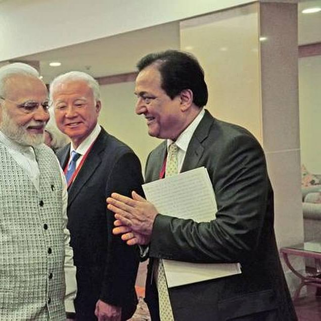 (Left) PM Narendra Modi with (Right) Rana Kapoor