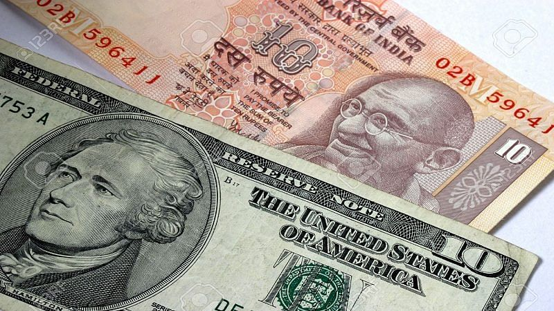 Rupee slides 70 paise to record low of 76.34 against dollar
