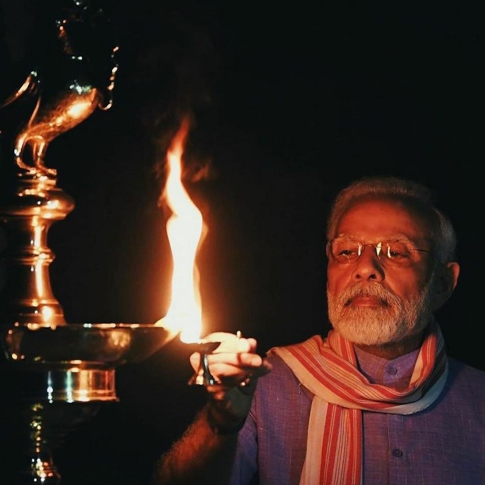 PM Narendra Modi lighting a lamp at his residence (Courtesy: social media)