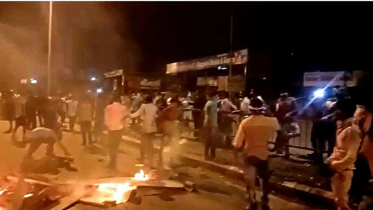 Stranded migrant workers in Surat set carts on fire, demand food, salary and transport