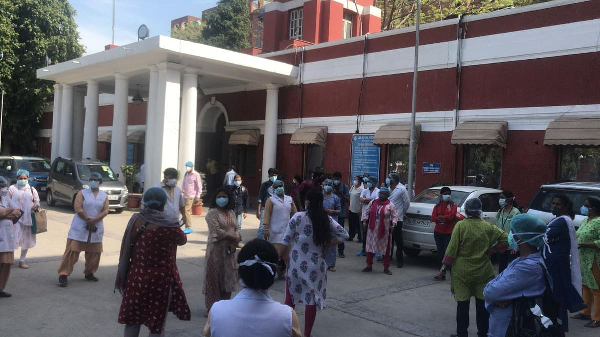 COVID-19: LNJP Hospital nurses stage protest against lack of sanitised accommodation, PPE suits