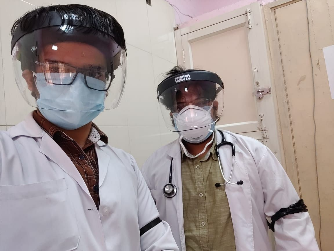Medics hold 'black ribbon' protest against new quarantine guidelines
