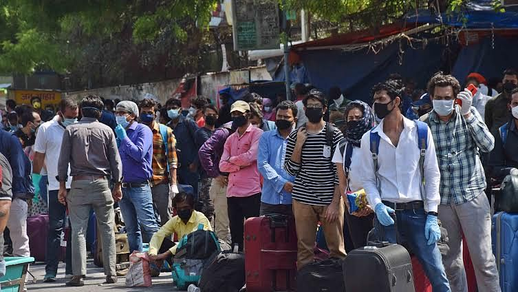 With no transport available for onward journeys, scores left stranded on roads outside New Delhi station