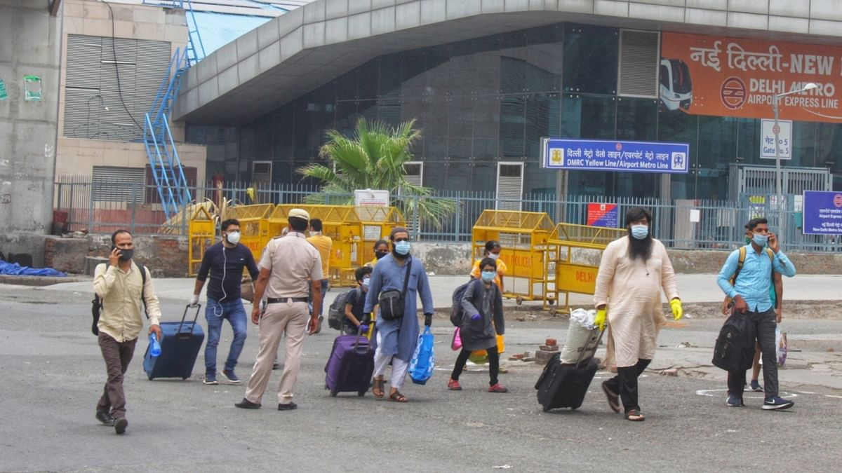 Stranded hotel workers work as coolies at New Delhi station