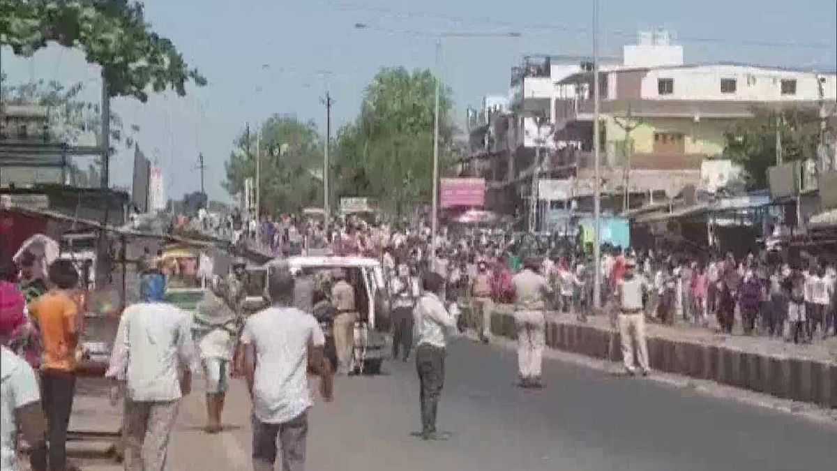 Gujarat: Desperate migrant workers clash with police in Surat