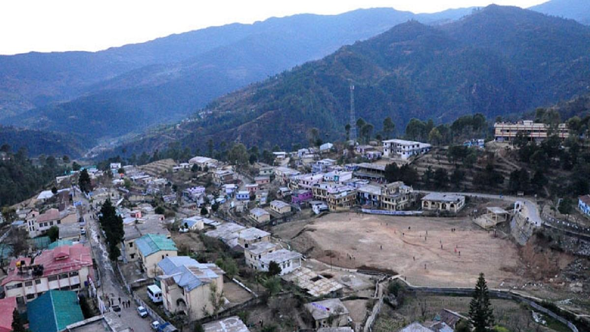Why does Uttarakhand need a summer capital?