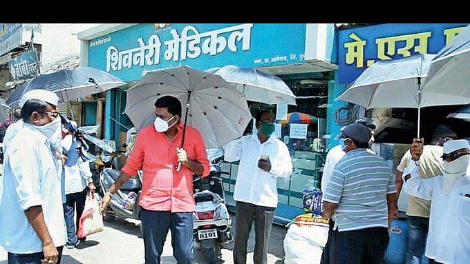 Maharashtra: Pune village uses umbrella as social distancing tool