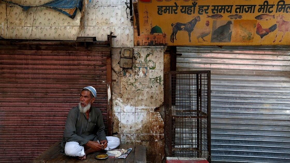 Meat seller outside his closed shop