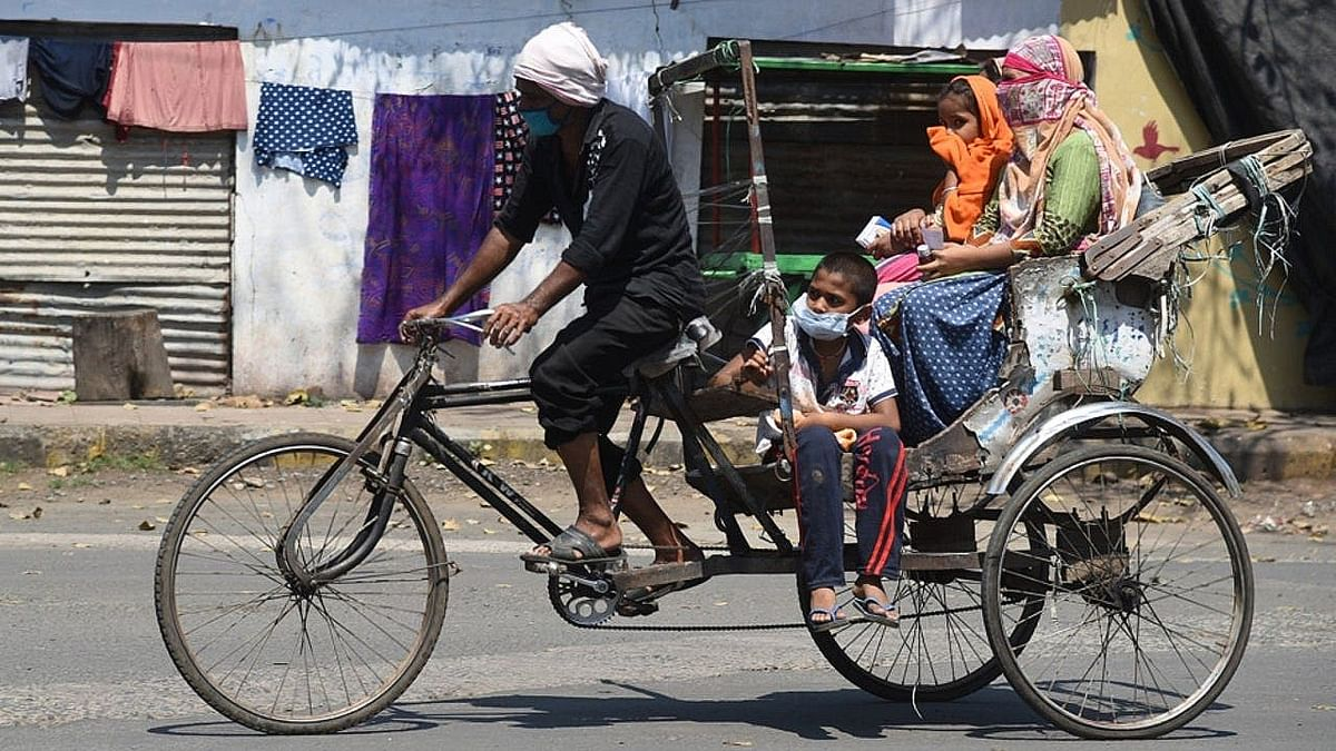 Migrant family travels home on cycle cart, 'rickshaw' now a reminder of tough times