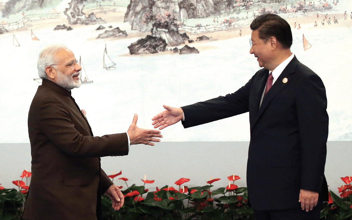 <b>Xiamen, China, September 4, 2017: </b>Prime Minister Narendra Modi shakes hands with Chinese President Xi Jinping prior to the dinner on September 4, 2017 in Xiamen, China
