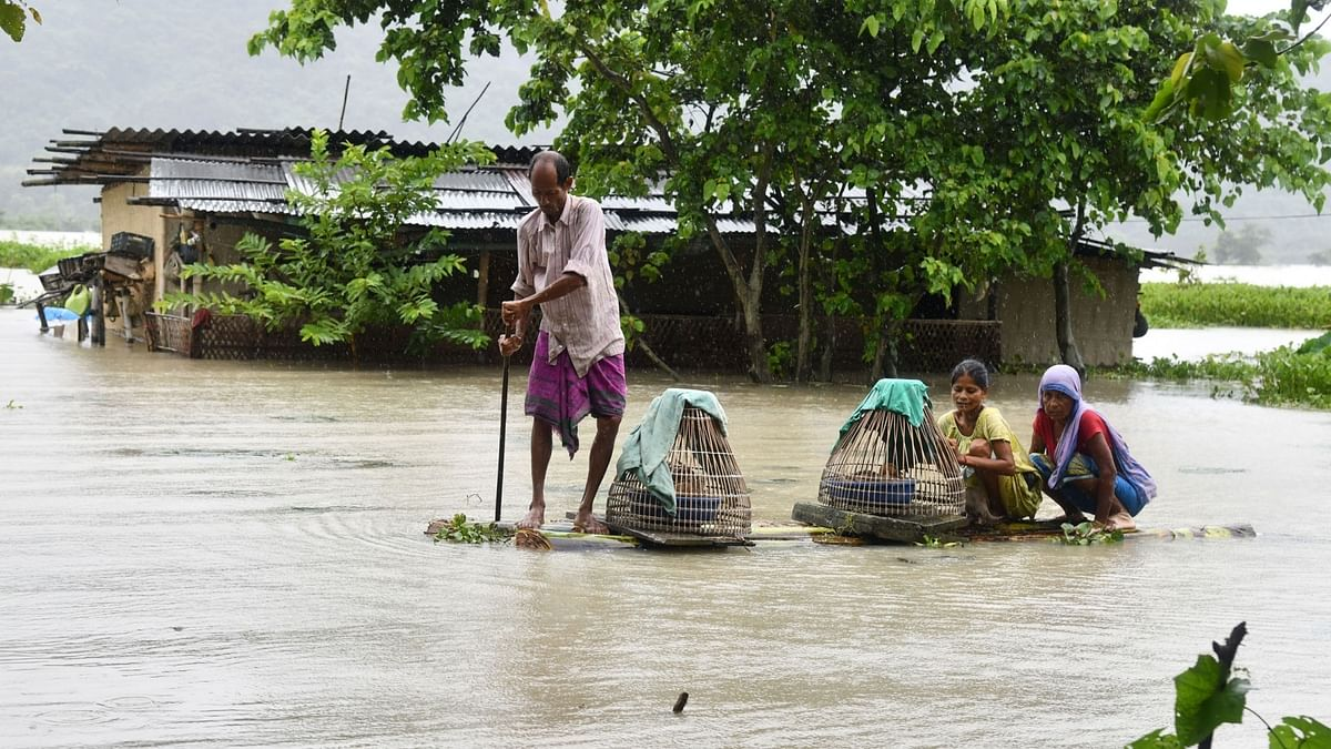 People move to higher places in flood hit Morigaon, Assam
