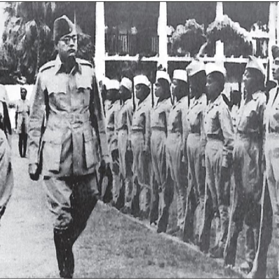 Subhas Chandra Bose, inspecting the guard of honour presented by the Rani of Jhansi Regiment during the opening of the Rani of Jhansi camp, Singapore
