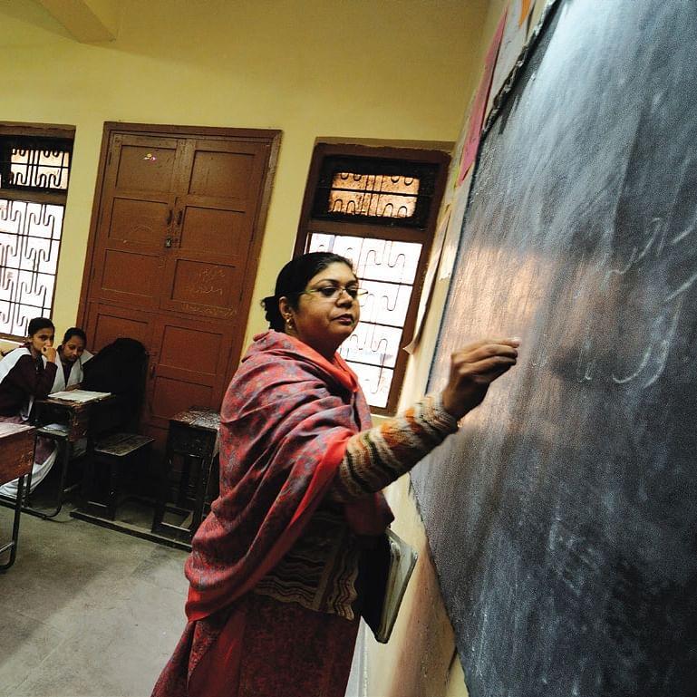 A teacher teaching in class at Sarvodaya Kanya Vidyalaya school at Chandni Chowk