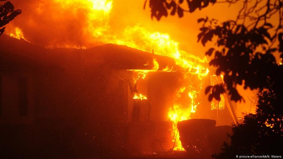 California wildfire explodes, burning across 25 miles in day