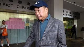 Arrested HK media mogul taken to his yacht as part of probe