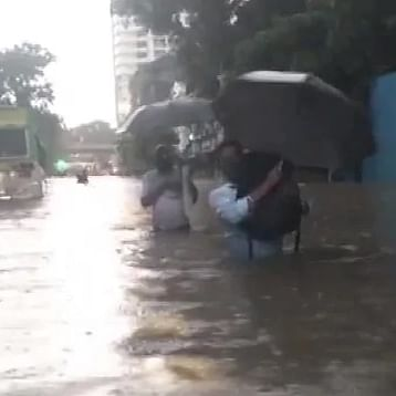 Heavy rains pound Mumbai, landslide hits road, rail traffic